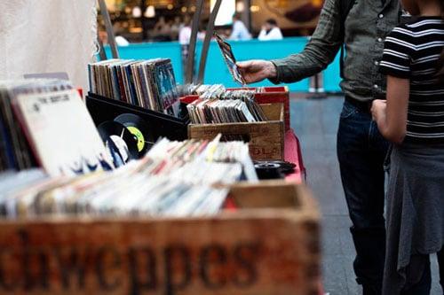 Selling vinyls at a garage sale.